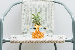 Pineapple with glasses is worn
