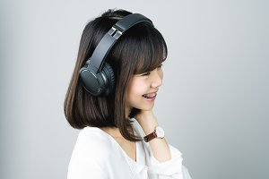 Asian gir listening to music.