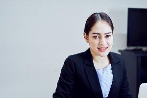 Businesswoman in black suit of smile