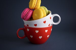 macarons in a white ceramic cup