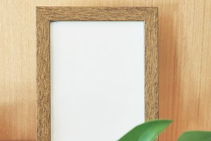 Empty wooden frame rests on the wall