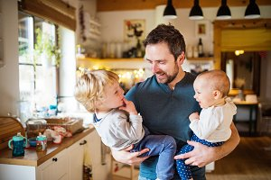 Father with two toddlers at home.