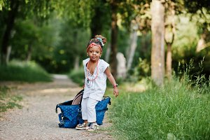 Funny african baby girl with big bag