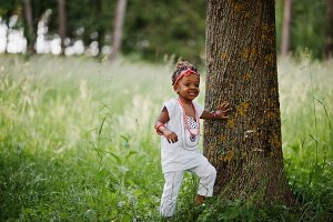 African baby girl walking at park
