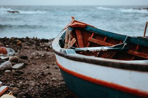 Fishing boat on shore during stormy Atlantic ocean. Sinagoga location on Santo Antao Island. Cape Verde