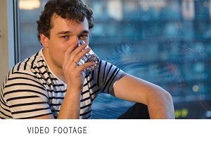 Man drinking water sitting