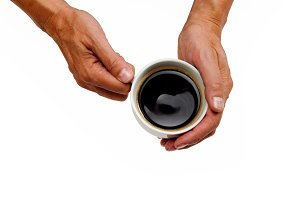 Hand holding a coffee cup