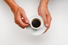 Hands holding a coffee cup
