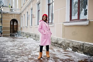 African girl in pink coat at winter