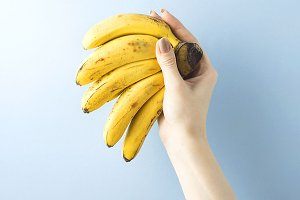 Holding bananas.