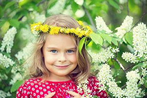 Little girl in spring flowers