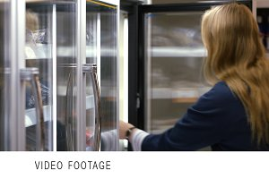 Woman taking frozen product from