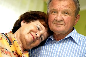 Romantic senior couple at home