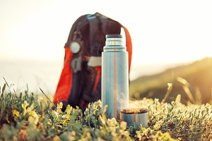 Thermos and cup of hot drink outdoor