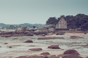 House and granite rocks in the coast