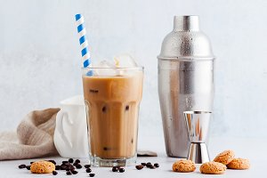 Coffee frappe in a tall glass with i