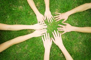 Group of friends joining hands