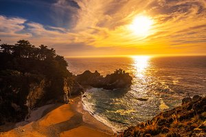 Sunset over McWay Falls on Pacific Coast Highway in California