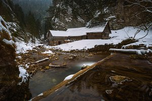 Old wooden water mill in winter