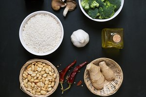 Chinese food raw ingredients, vegetables and nuts on the dark background. Flat lay