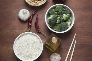 Chinese food raw ingredients, vegetables and nuts on the rustic wooden background