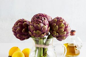 Fresh bunch of purple artichokes in