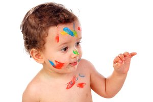 Funny baby with paint in his face