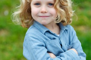 Handsome child with long blond hair