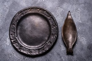 Empty black ceramic plate