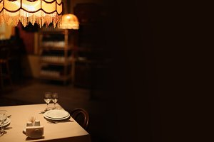 Night cafe interior. Warm light.