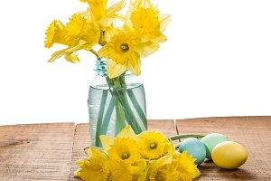 Daffodils in a blue mason jar