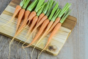 Fresh and sweet carrot on wood