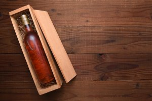 Bottle of Blush wine in its wood Box