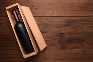 Bottle of red wine in its wood Box