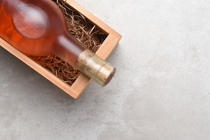 bottle of Rose wine in a wood box