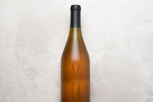 Chardonnay Bottle on Concrete Table