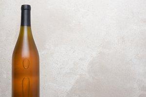 Chardonnay Bottle on Concrete Table