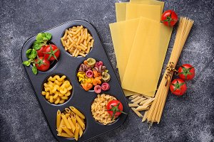 Various type of pasta and cherry tomato