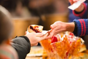 Hands holding piece of apple pie