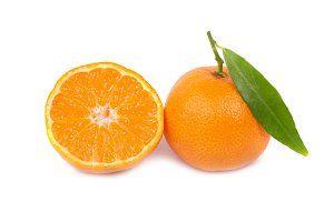 Two orange mandarins with green leaf