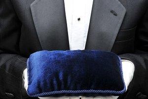 Butler with Velvet Pillow in Hands