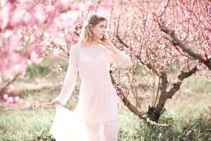 Girl in peach orchard