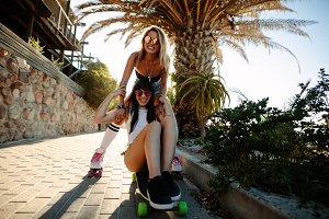 Cheerful female friends skating