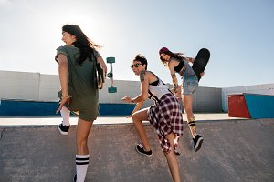 Happy female friends running