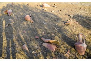Archaeological excavations. Broken ancient amphorae on the ground.