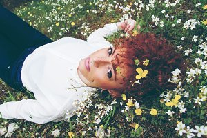 Young redhead woman rest in nature