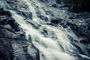 Mountain waterfall on summer day