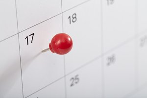 A red pin on calendar to remind about the appointment