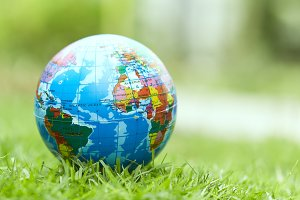 Concept Earth Day ,Globe lies on green grass.