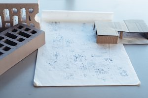 Architect desk with drawing sketches